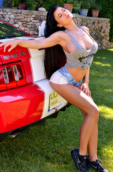 Lucy Li Posing With A Sports Car