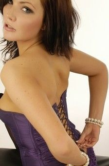 Hot Brunette Chloe James Posing In Purple Corset
