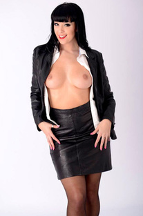 Busty Secretary In Leather Costume