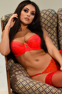 Charley Teasing In Her Red Lingerie And Stockings
